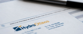 Close up of a pen on top of a Hydro Ottawa electricty bill